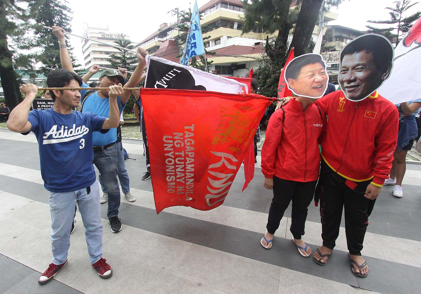 BAGUIO CITY. Protesters wear masks of Chinese President Xi Jinping and President Rodrigo Duterte on Monday, July 22. Photo by Mau Victa/Rappler