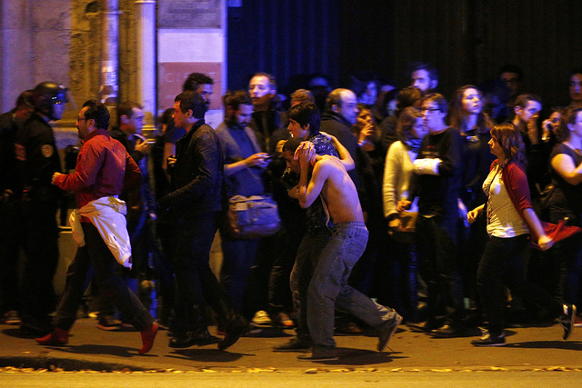 EVACUATED. Wounded people are evacuated outside the scene of a hostage situation at the Bataclan theatre in Paris, France, November 14, 2015. Photo by Yoan Valat/EPA