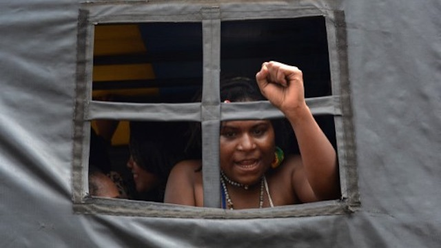 PROTEST. An arrested Papuan pro-independence demonstrator gestures from a police truck in Jakarta on December 1, 2015, after police fired tear gas at a hundreds-strong crowd hurling rocks during a protest against Indonesian rule over the eastern region of Papua. File photo by AFP