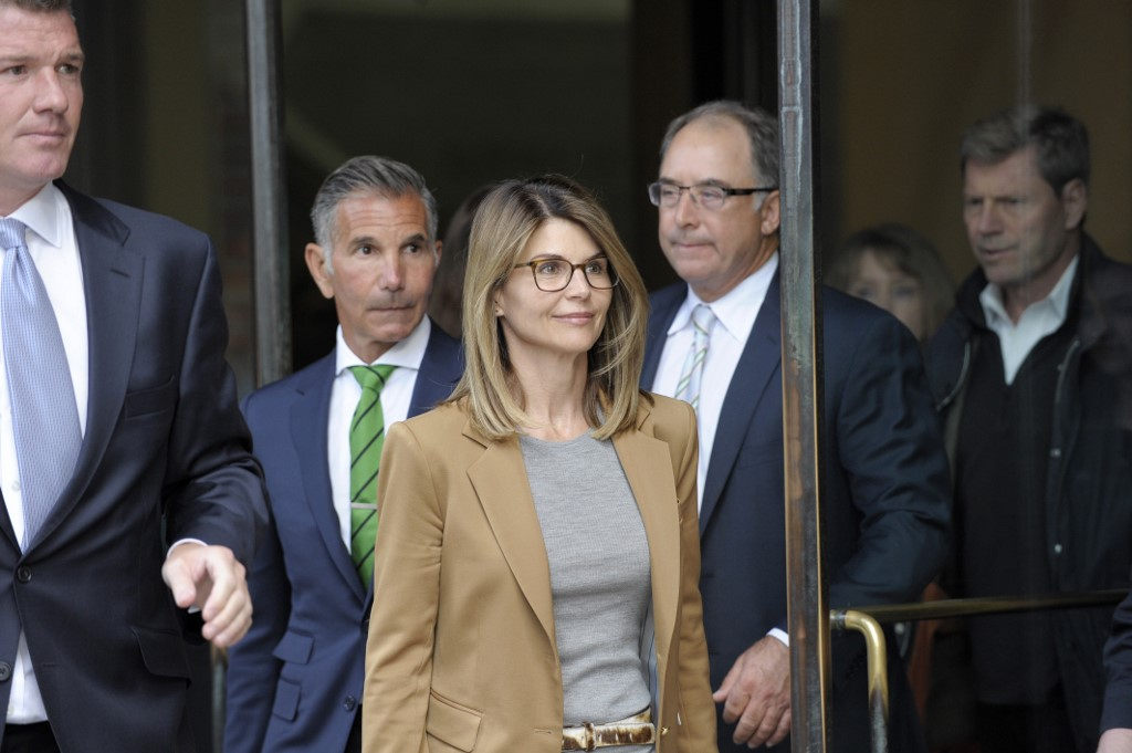 NOT GUILTY. File photo shows actress Lori Loughlin exiting the courthouse after facing charges for allegedly conspiring to commit mail fraud and other charges in the college admissions scandal. She and her husband have pleaded not guilty. Photo by Joseph Prezioso / AFP