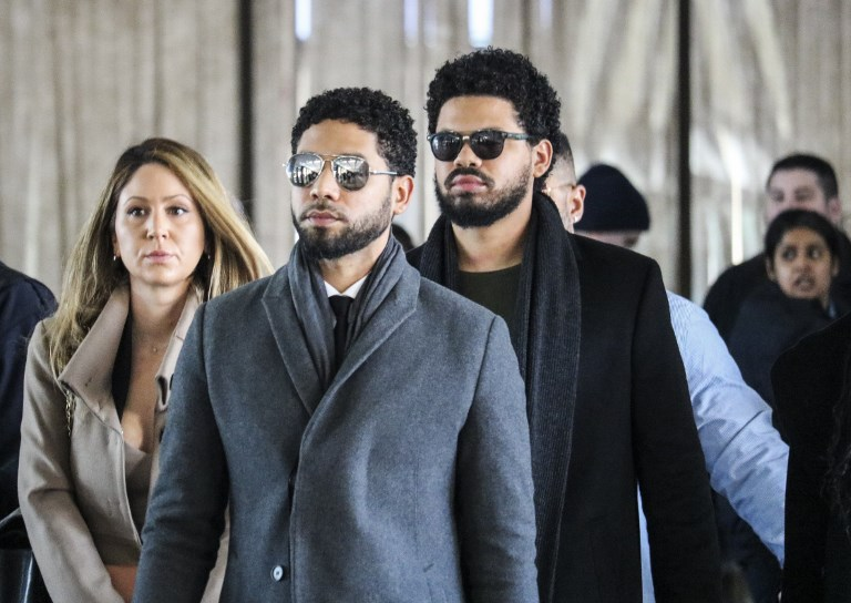 MISINFORMATION. Actor Jussie Smollett and team arrive for a court hearing at the Leighton Criminal Courthouse on March 12, 2019 in Chicago. Photo by Derek Henkle/AFP