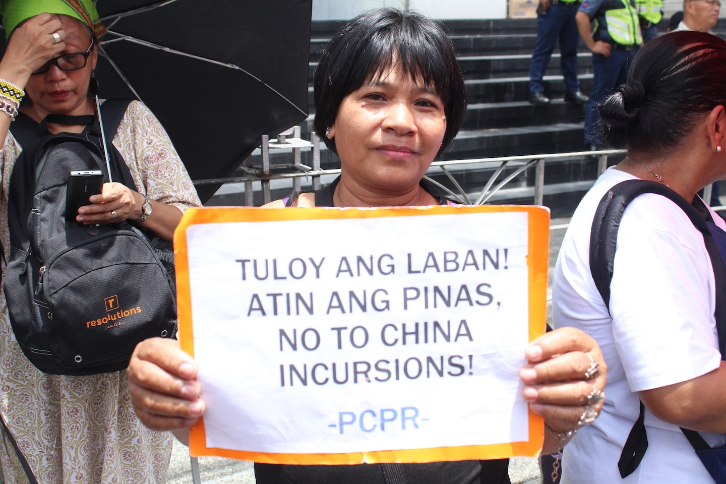 Emily Soriano holds a placard during the End Dependence Day protest on June 12, 2019 as she takes part in the fight of her community. Photo by Elijah Macaspac/Rappler