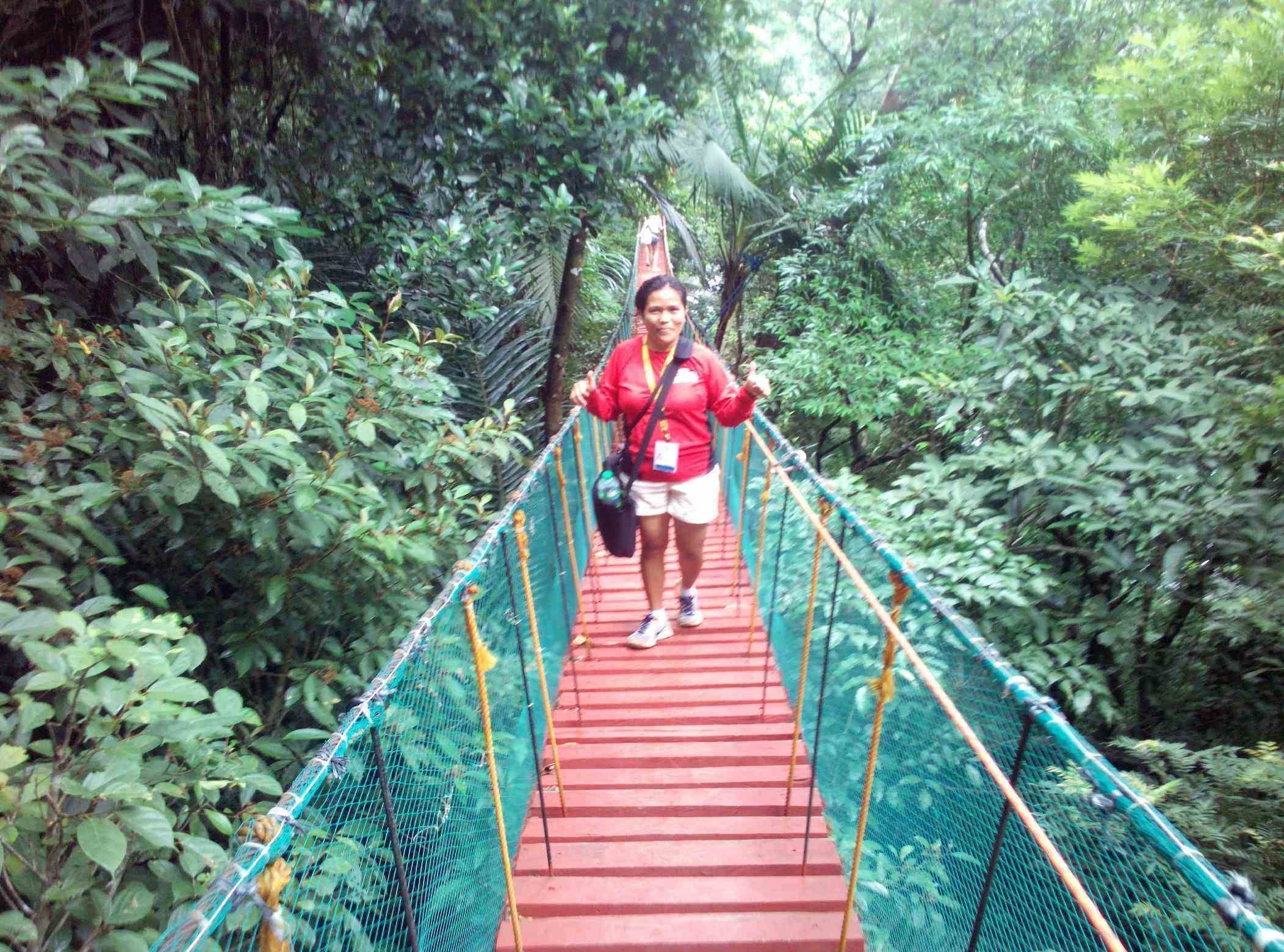 COURAGE. Ate Virgie used to take this hanging bridge almost everyday to end the every tour she handles. While all of us cross the bridge with harness and shaking knee, she courageously lead the way without any safety gear
