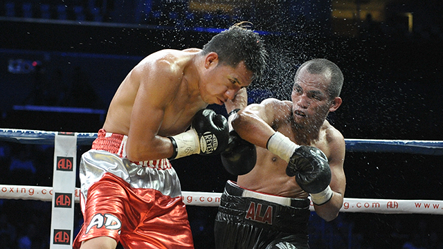 Milan Melindo lands a right hand on Martin Tecuapetla during his bout in May 2014. File photo by Denmark Delores