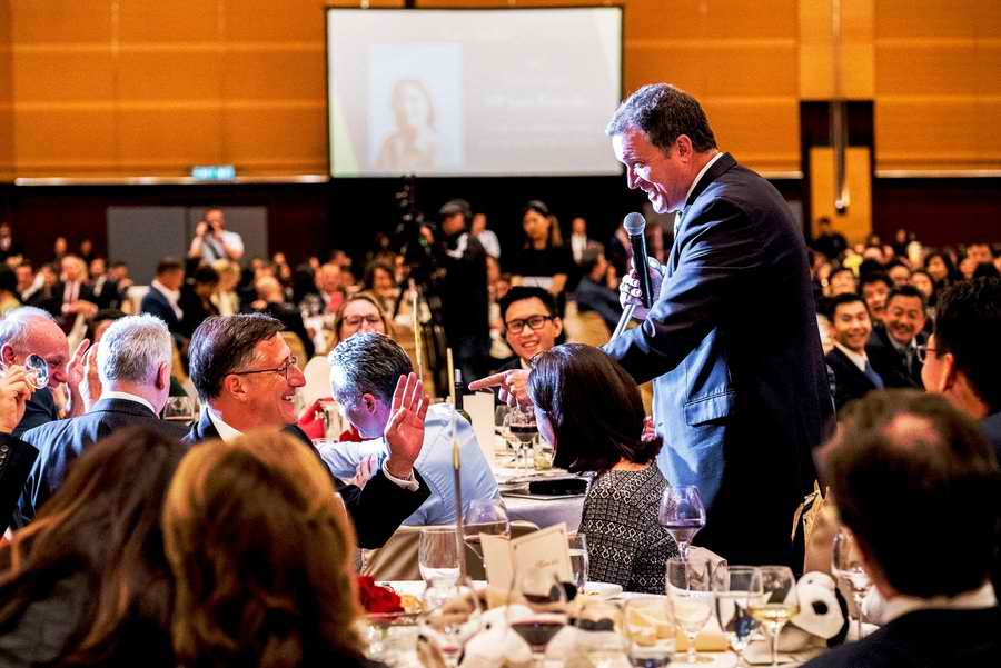 BIDDING. Professional auctioneer Joff van Reenen coaxing one of the guests to bid more for the VP dinner. Photo courtesy of Daisy C.L Mandap