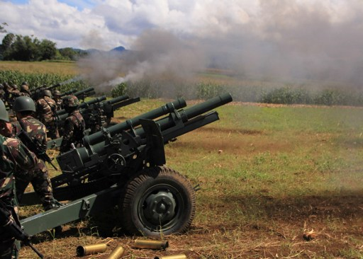 CANNONS. Philippine troops fire their 105mm howitzer cannons towards enemy positions from their base near Butig town in Lanao del Sur province on the southern island of Mindanao on November 27, 2016. Troops on November 27 fired artillery at positions held by an Islamic militant faction in the southern Philippines as more soldiers deployed against the group, which staged a deadly bombing in President Rodrigo Duterte's home city. RICHEL UMEL / AFP