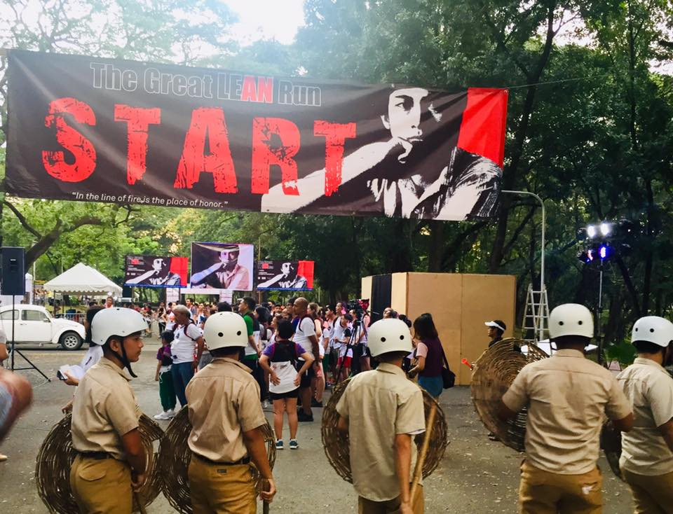 MARTIAL LAW. Individuals portray Metrocom officers during the Marcos regime in a fun run at the University of the Philippines Diliman to remember the atrocities during Martial Law. Photo from 'The Great LEAN Run' Facebook page