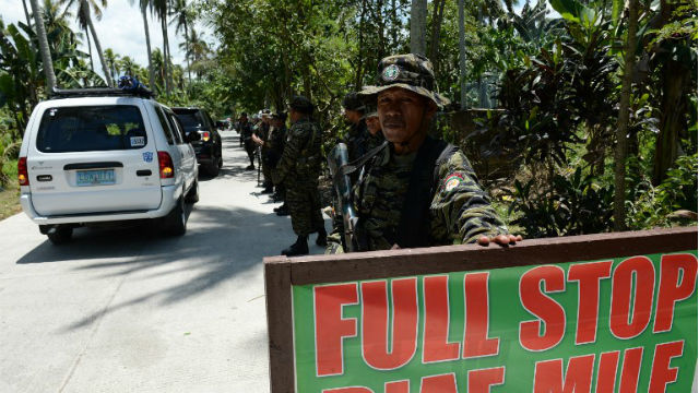 Moro Islamic Liberation Front (MILF) rebels man a check point inside Camp Darapanan, Sultan Kudarat town. AFP file photo