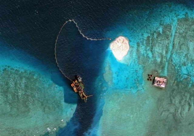 VIETNAM CONSTRUCTION. This satellite image shows Vietnam's reported construction activities on Sand Cay, one of the features of the Spratly Islands in the disputed South China Sea. Photo courtesy of SIS Asia Maritime Transparency Initiative/DigitalGlobe
