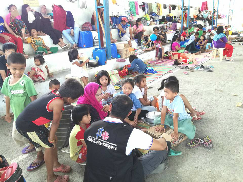 EVACUEES. NASSA/Caritas Philippines during its rapid needs assessment in one of the evacuation areas in Iligan City. Photo courtesy of NASSA/Caritas Philippines