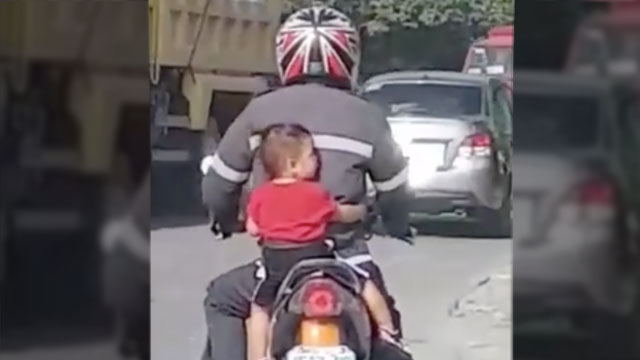 UNSAFE AND ILLEGAL. A video shows a toddler riding a motorcycle without a helmet. Screenshot from Pinoy Law Breakers Facebook page