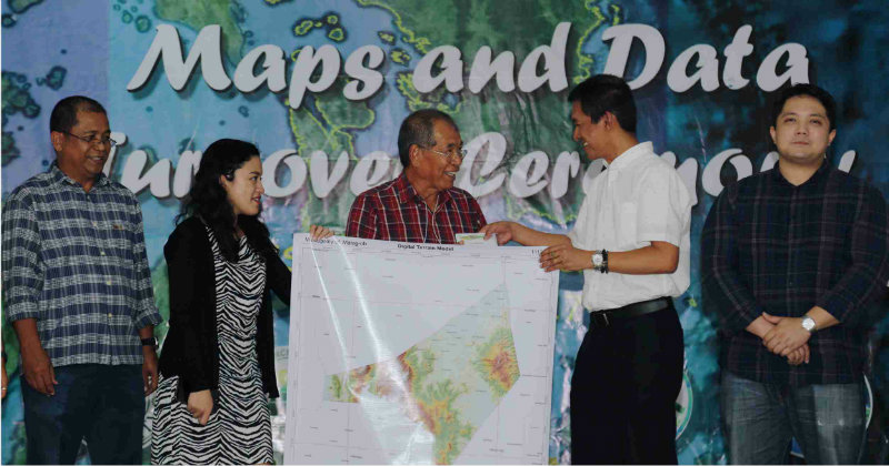 HAZARD MAPS. Visayas State University president Edgardo Tulin (in white) leads the turnover of flood and resource maps to officials of disaster-prone towns in Eastern Visayas. Photo by Aliana Gene Sarmiento/VSU Web Team