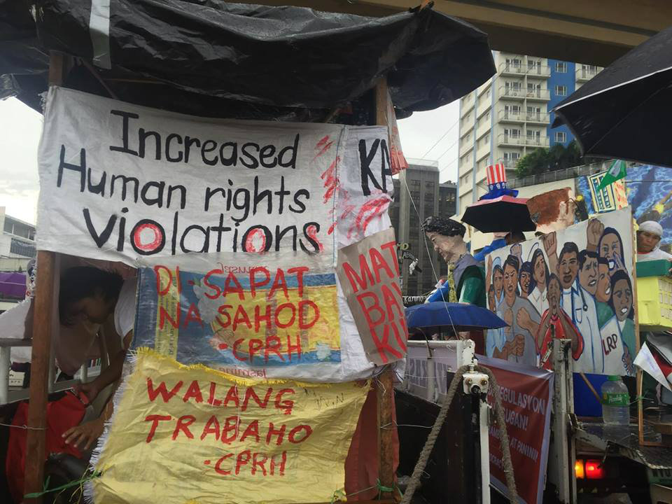 RALLY. Trucks raise banners asking the Duterte administration to stop human rights violations