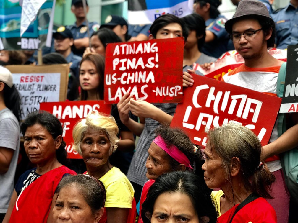 LAND IS OURS. Elderly members of the Dumagat Tribe from the Sierra Madre mountains join various groups at a protest action in Makati City to fight for their ancestral land. Photo by Kurt Dela Peña/Rappler.com