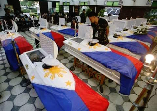 THE FALLEN. In this file photo, flag-draped coffins carrying the 18 soldiers killed in Basilan on April 9, 2016 are seen at the Western Mindanao Command headquarters in Zamboanga City, April 10, 2016. Photo via Richard Falcatan