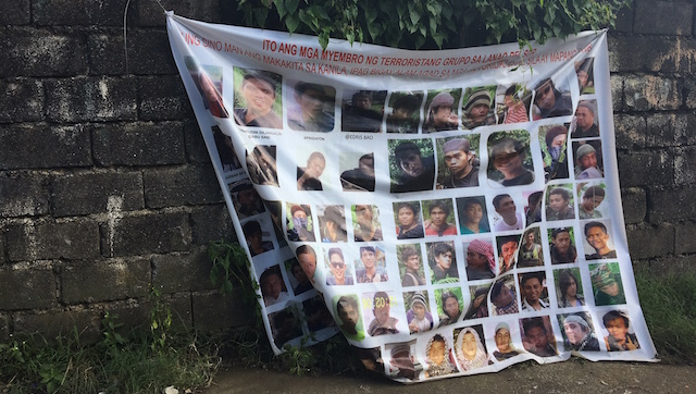 SUSPECTS. A banner across the street from a military camp in Marawi shows the faces of suspected members of the Maute Group. Rappler photo