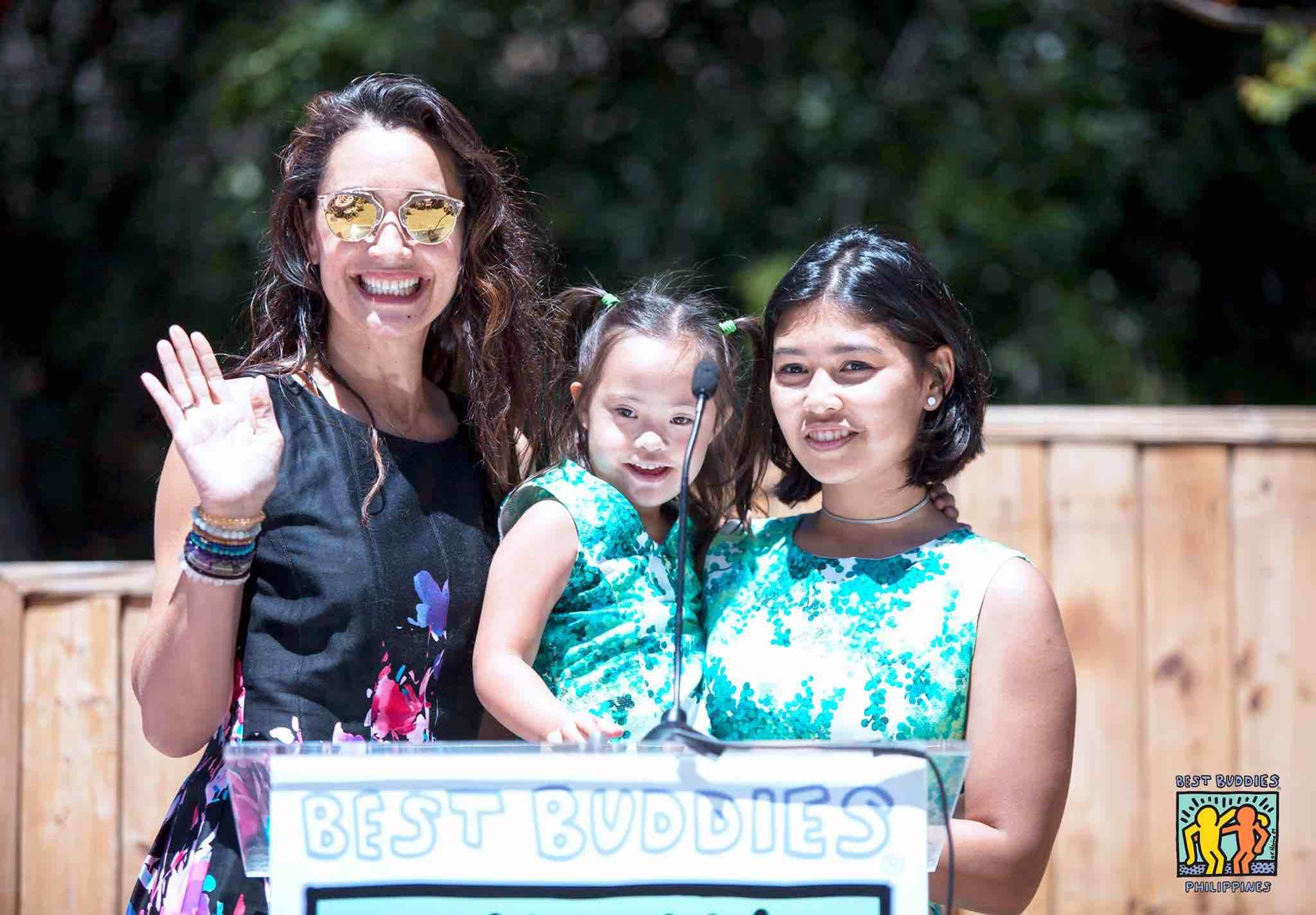 MOTHER OF THE YEAR. Filipina blogger and PWD advocate Michelle Ressa Aventejado, who is Best Buddies International's Mother of the Year, is all smiles with her daughters Gelli and Gia. Photo courtesy of Best Buddies Philippines