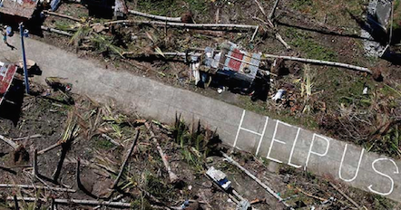 MASA DEPAN KEMANUSIAAN. Sebuah komunitas yang menjadi korban dahsyatnya topan Haiyan menulis pesan untuk kemanusiaan.