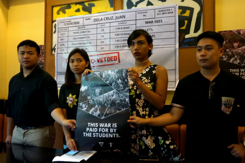 BOOKS NOT BOMBS. Benjie Aquino, Jeza Rodriguez, Amber Quiban and Richmond Roxas warn Duterte against neglecting promises to students. All photos by Gari Acolola