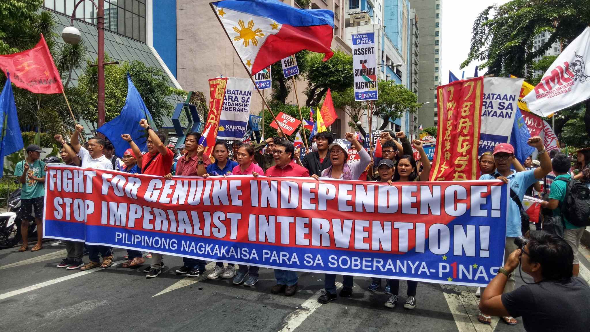 MAKATI. Various youth and student groups rally at the Chinese Consulate in Makati City on Independence Day to uphold national sovereignty as China continues to occupy the disputed islands in the West Philippine Sea. Photo by John Philip Bravo/Rappler
