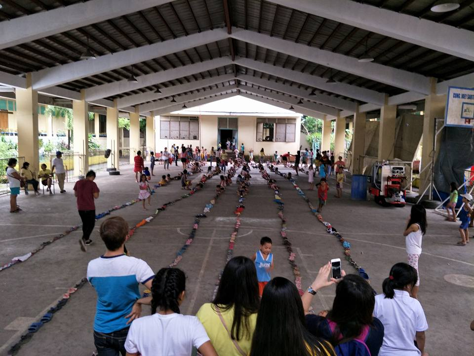 KIDS HOUR. Fun games, gift giving, and feeding for the children evacuees in Albay Central School, Brgy. Matang. Photo from Social Action Center Legazpi Facebook page
