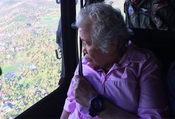 AERIAL INSPECTION. Education Secretary Leonor Briones on Tuesday, December 27, joins an aerial inspection of the areas affected by Typhoon Nina. Photo courtesy of DepEd