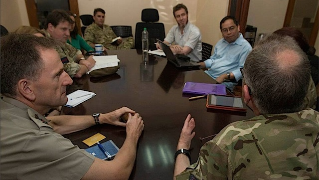 COLLABORATION: The 77 Brigade meets with officials of Catholic Relief Services in Manila. Photo by Cpl Mark Larner RY