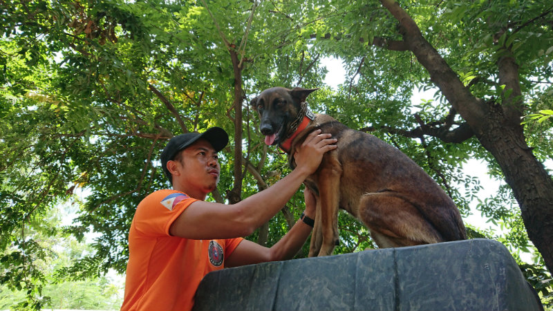 MAN'S BESTFRIEND. George Tomagan of the MMDA K-9 Corps poses with dog Vera. Photo by Renzo Acosta