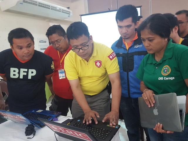 TECHNOLOGY FOR DISASTERS. ERIC Managing Director Bong Grajo lectures DRRM officer on how to use the disaster information system