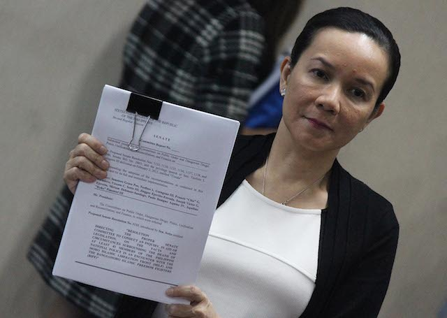 SKEWED UNDERSTANDING? Senator Grace Poe shows the Senate report on Mamasapano, which the Commission on Human Rights is criticizing. File photo by Joel Leporada/Rappler