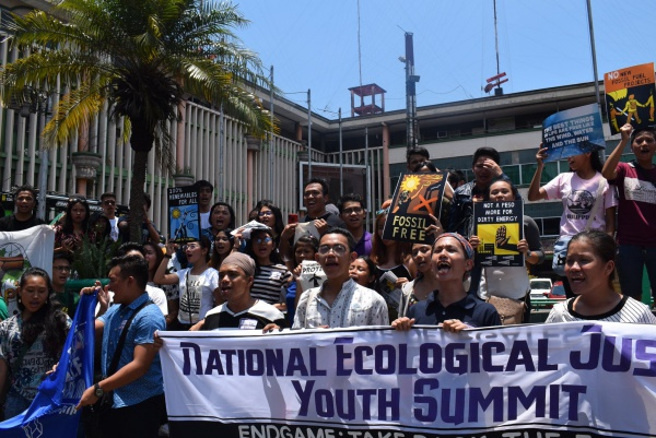 CALL TO ACTION. Youth leaders from across the Philippines gather in a unity declaration protest to stop environmental destruction and push for climate justice. Photo by Claudia Gancayco