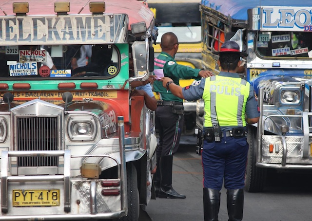 HPG. A member of the HPG manages traffic along EDSA in Metro Manila. File photo by Joel Leporada/Rappler