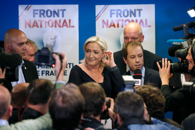 VICTORY. Marine Le Pen leaves the stage after delivering her speech after the far-right National Front is the top vote winner in France's election for the European Parliament, near Paris, France, May 25, 2014. Yoan Valat/EPA
