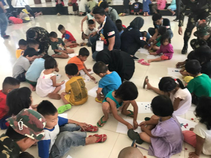 PSYCHOSOCIAL SUPPORT. At least 70 child refugees participate in the activities co-organized by the Philippine army. All photos from AFP