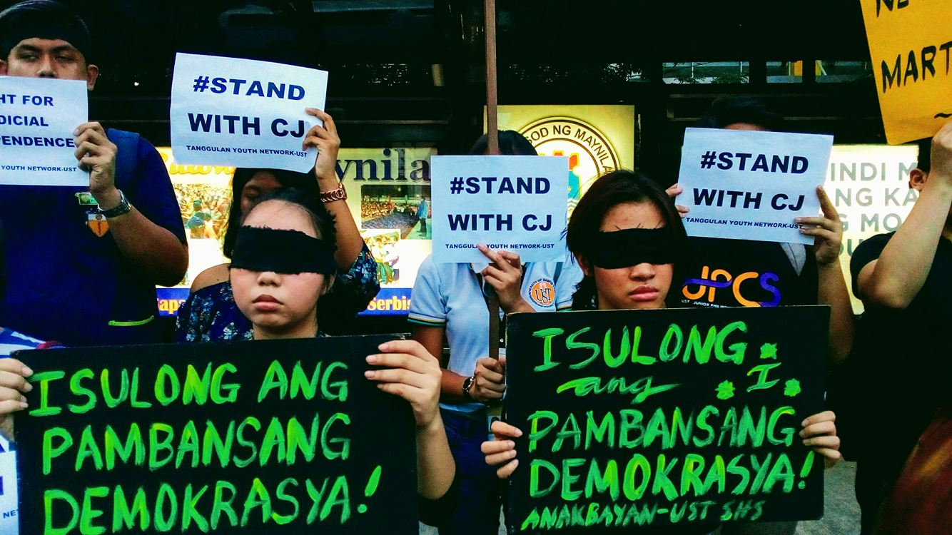BLINDFOLDED. UST students gather in Espana, Manila in support of th oustered if Justice. Photo by Philip Jamilla