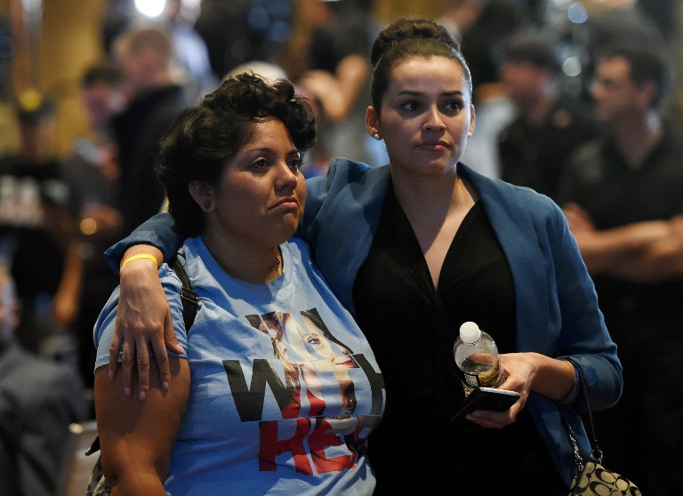 ACCEPTANCE. Hillary Clinton supporters console one another in Las Vegas as the reality of a Donald Trump presidency sets in. Photo by Ethan Miller/Getty Images/AFP