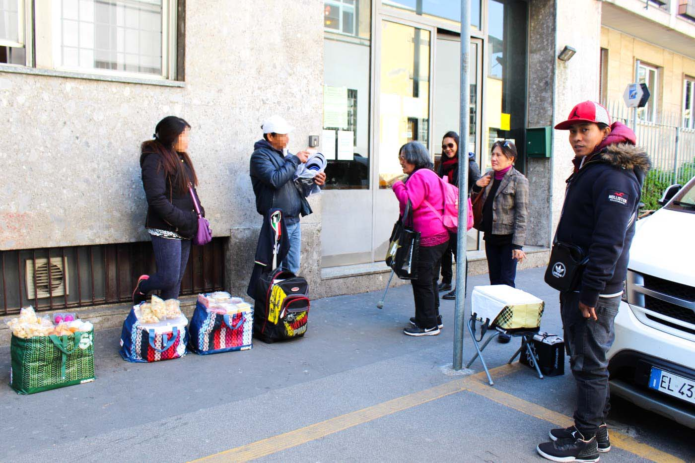 MULTIPLE JOBS. Junjun Paran selling Filipino treats outside the Philippine Consulate office in Milan, Italy. Photo by Don Kevin Hapal/Rappler