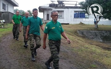 FIRST STEP. Senior members of the Moro Islamic Liberation Front arrive at the venue of the symbolic turnover of firearms on June 16, 2015. Photo by Rappler