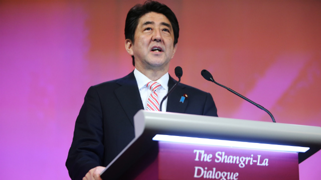 SPEECH. Japanese Prime Minister Shinzo Abe gives the keynote address on the first day of The International Institute for Strategic Studies (IISS) 13th Asia Security Summit in Singapore, 30 May 2014. Photo by How Hwee Young/EPA