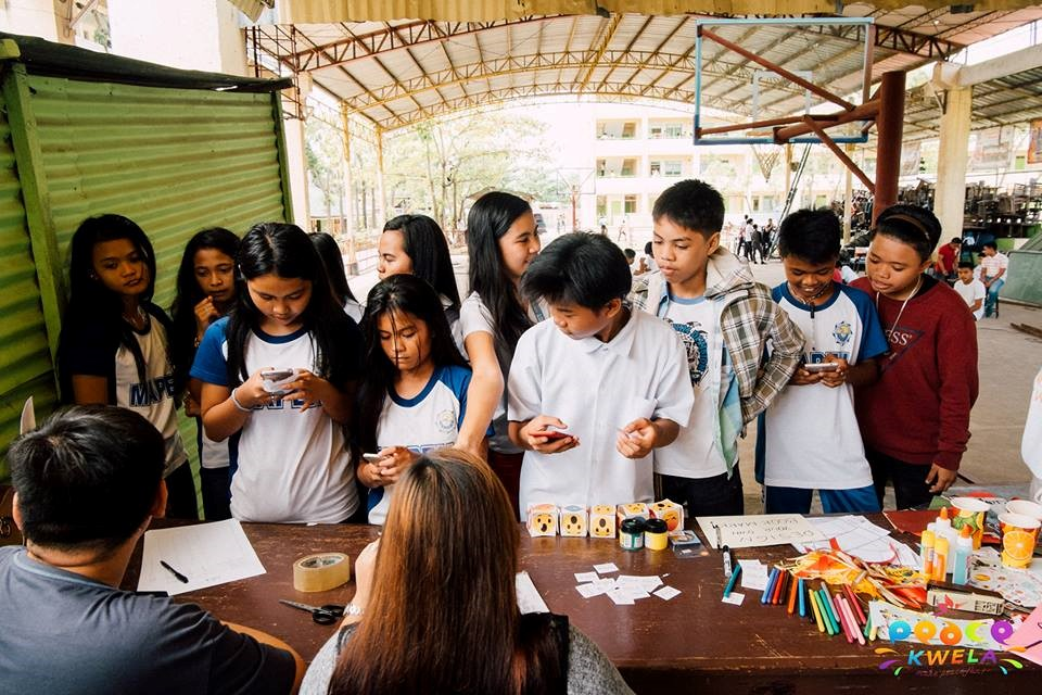 ENGAGED. Junior high school students from Bulua National High School gather in front of PeaceKwela's Peace Info Booth in their school. Photo from PeaceKwela