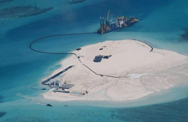 CHINA'S RECLAMATION. The Philippines releases this photo in May of China's alleged reclamation in Johnson South Reef in the South China Sea, warning it may be building an airstrip. Photo courtesy of the Department of Foreign Affairs