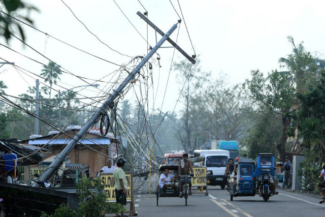 CHRISTMAS TYPHOON. Motorists ride past electric posts damaged by Typhoon Nina (Nock-ten) in Tabaco, Albay on December 27, 2016. Photo by Charism Sayat/AFP