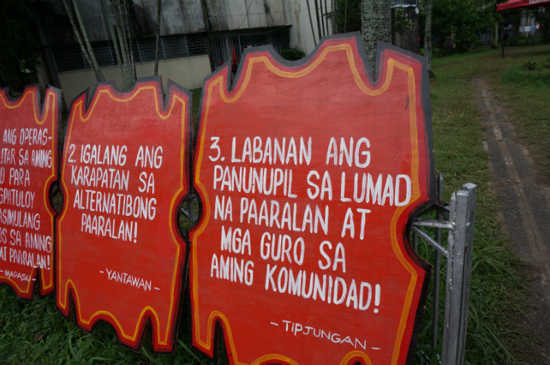FIGHT FOR EDUCATION. Placards used by Lumads during protests now lie in front of their camp in Manila. All photos by Gari Acolola