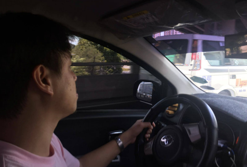 AFFECTED UBER DRIVER. Ronan Barrientos is one of the 60,000 Uber drivers who will be affected by the LTFRB suspension. Photo by Raisa Serafica