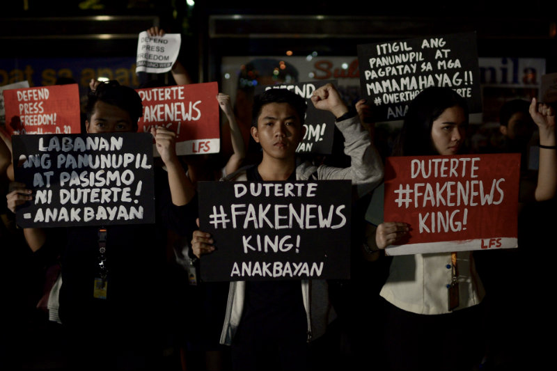 PROTEST. UST students protest the award given by the UST Alumni Association Inc. to Mocha Uson. All photos by Eloisa Lopez/Rappler