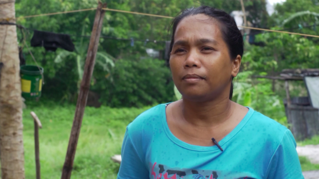 HOPEFUL. Agnes Salvaria of Barangay Taloto-an in Concepcion, Iloilo says the new shelter she received from Iloilo CODE-NGOs and Christian Aid will help her family rebuild their lives. Photo by David Lozada/ Rappler.