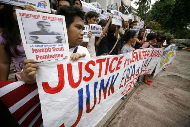 'JUSTICE FOR LAUDE.' Protestors at the University of the Philippines demand justice for transgender woman Jennifer Laude, 26, whom a US Marine allegedly murdered. Photo by Ben Nabong/Rappler