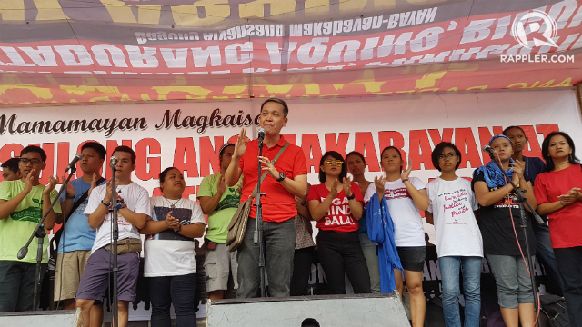STILL FIGHTING. BAYAN Secretary-General addresses the rallyists in Mendiola. Photo by Pocholo Espina/ Rappler
