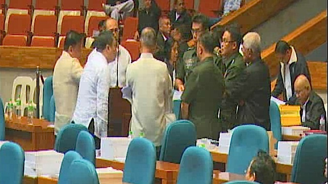 HUDDLE. Defense and military officials discuss issues raised by lawmakers.