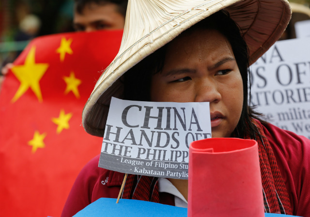 PROTEST VS CHINA. Filipino students on March 3, 2016, stage a protest in Manila, Philippines, against China's aggression in the West Philippine Sea (South China Sea). File photo by Mark Cristino/EPA